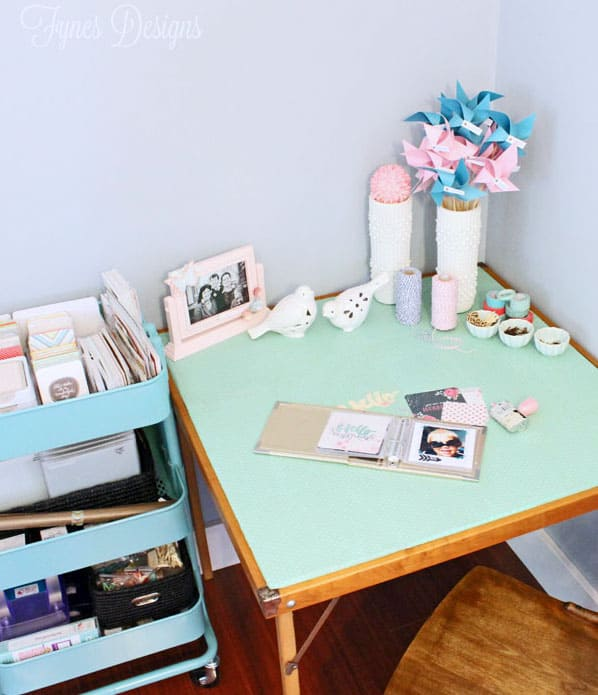 Quaint little craft space, Dress up a vintage card table by adding a layer of wrapping paper with Mod Podge