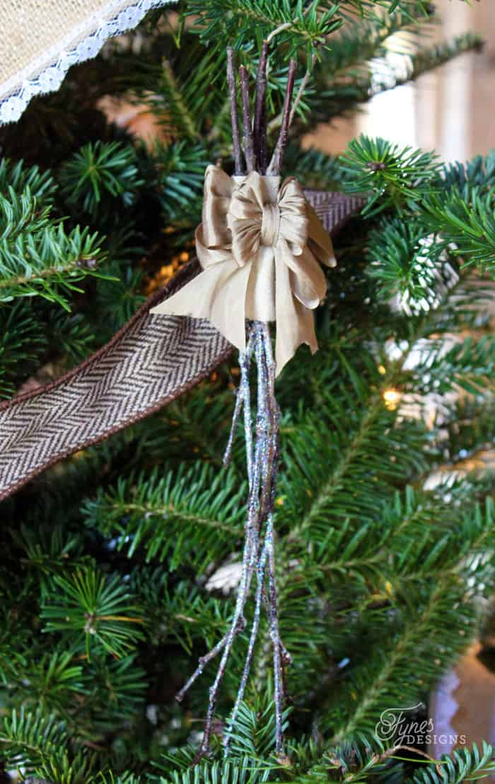 These snowy twigs look great dangling on the Christmas tree. They are a really affordable idea for Christmas tree decorations!