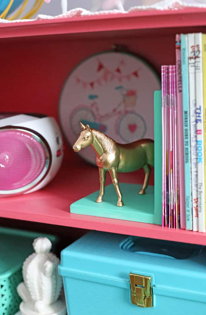 Handmade golden horse bookend made from a dollar store plastic horse